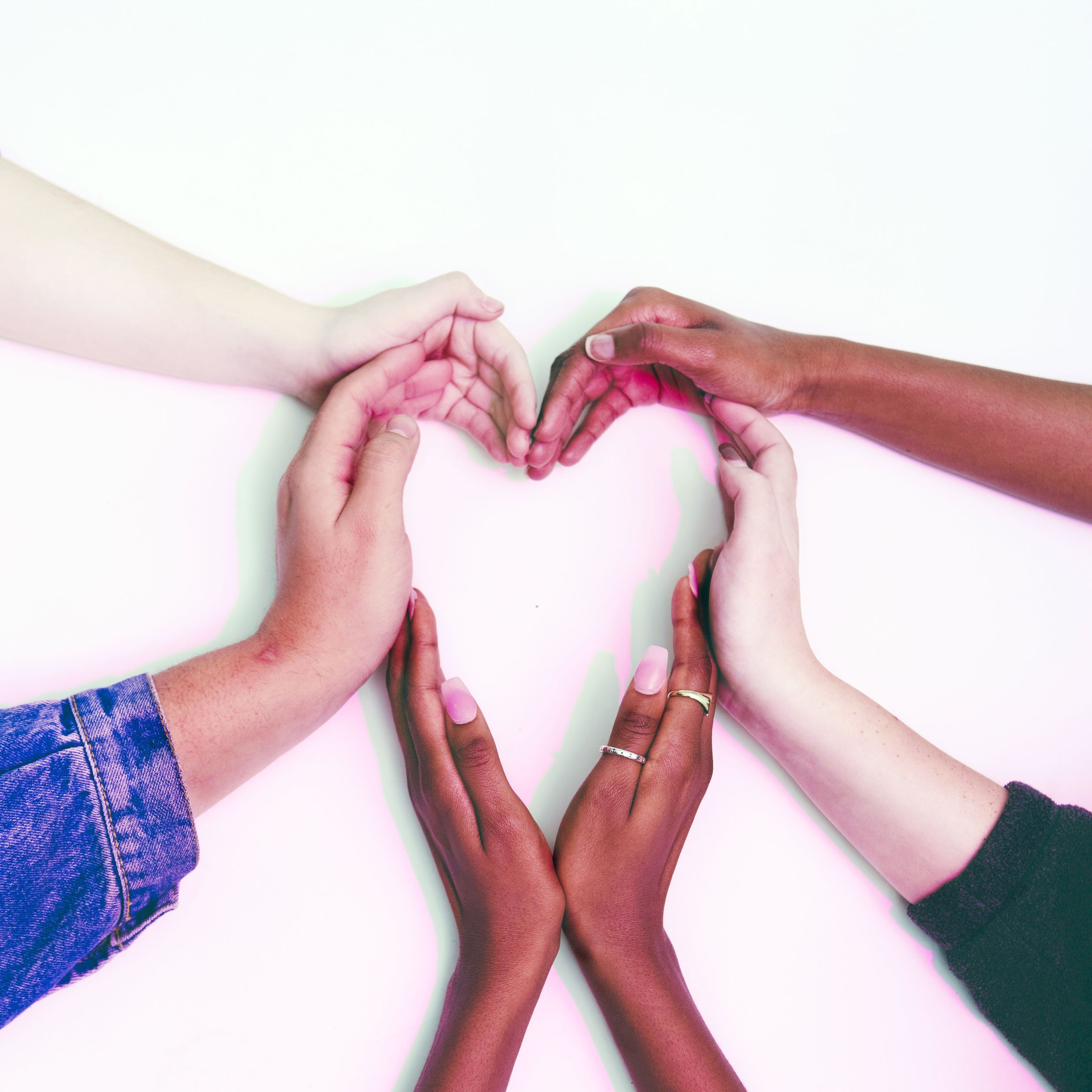 diverse hands forming heart shape
